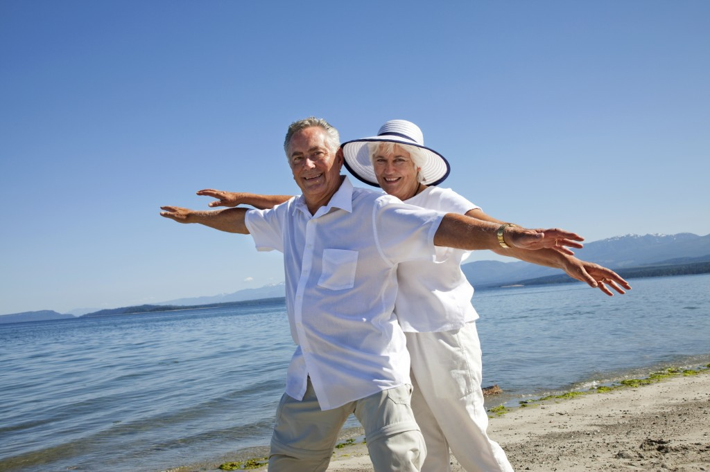 senior_couple_smiling_on_beach